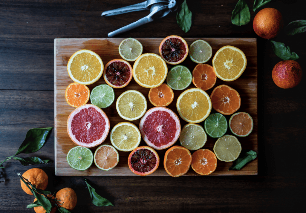 a variety of colorful citrus fruit